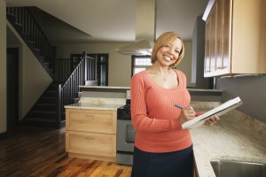 Woman inspecting house interior